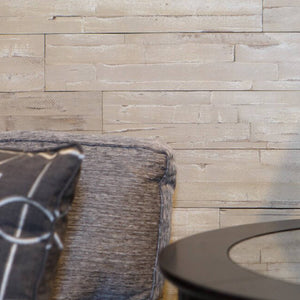 taupe self adhesive wood wall panels close up in a living room