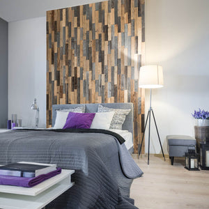 Wooden wall panels being used as a feature wall behind a bed within a bedroom