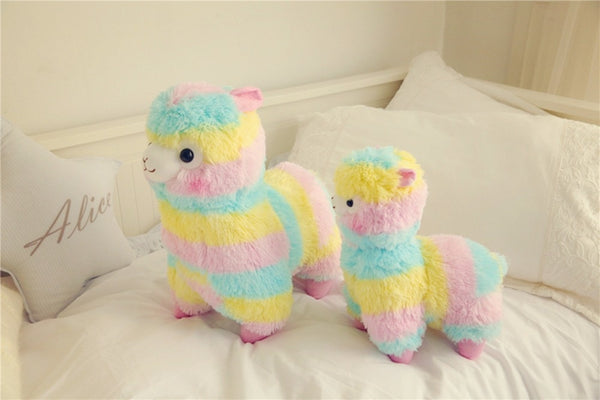 multi-colored rainbow stuffed alpaca plush with pale blue, yellow, and pink stripes