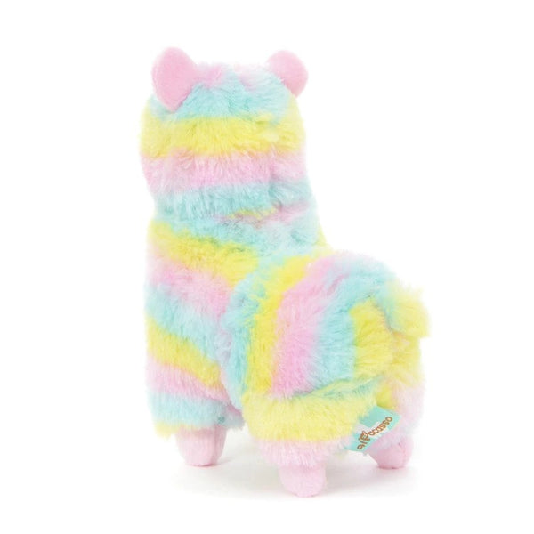 the backside of a multi-colored rainbow stuffed alpaca plush with pale blue, yellow, and pink stripes