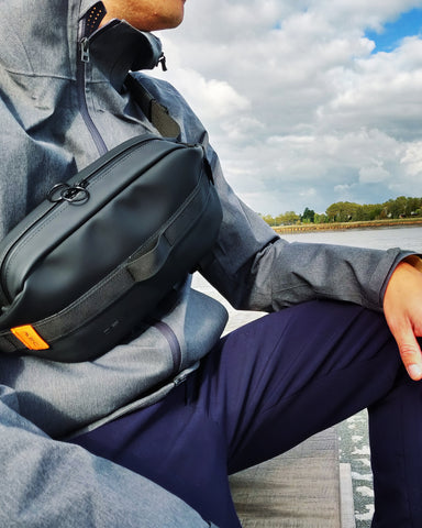 DEW waist bag over shoulder