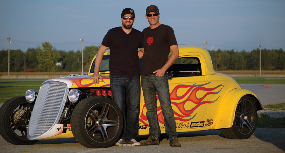 Rob & Andy McJannett standing in front of Project 33 their FactoryFive 33