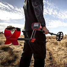 Minelab Vanquish being held by man