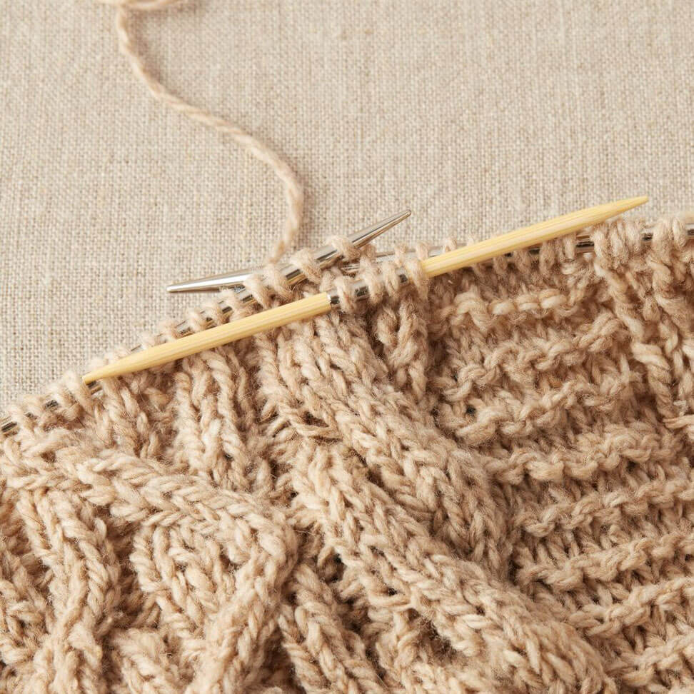 Cocoknits - Bamboo Cable Needles shown with all 5 needles laid on a cloth | Yarn Worx