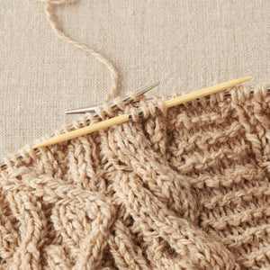 Cocoknits - Bamboo Cable Needles shown with one of the needs being used in work | Yarn Worx
