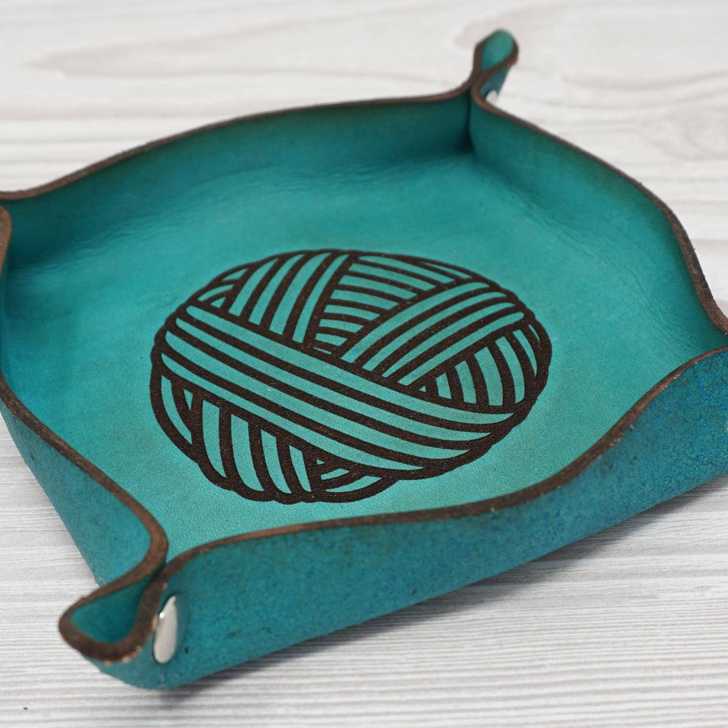 Birdie Parker Designs - Leather Valet Tray - shown in Turquoise colour. There is a ball of wool laser etched into the leather | Yarn Worx