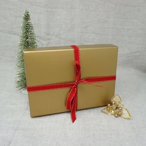 Christmas Yarn Gift in a gold gift tied with a red ribbon | Yarn Worx