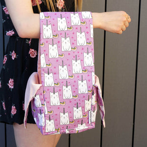 Heather Project Bag - Unikitty shown hung on a woman's arm | Yarn Worx