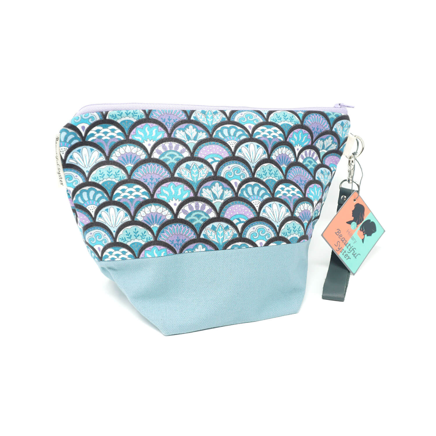 Beautiful Syster Hillary zipped project bag with mermaid scales design. Bag is shown standing up.