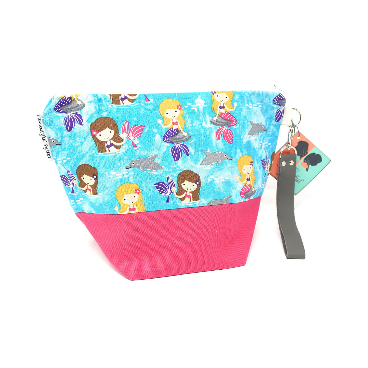 Beautiful Syster Hillary zipped project bag with mermaids fabric. Bag is shown standing up.