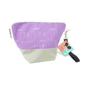 Beautiful Syster Hillary zipped project bag with beige and purple fabric. Bag is standing up.