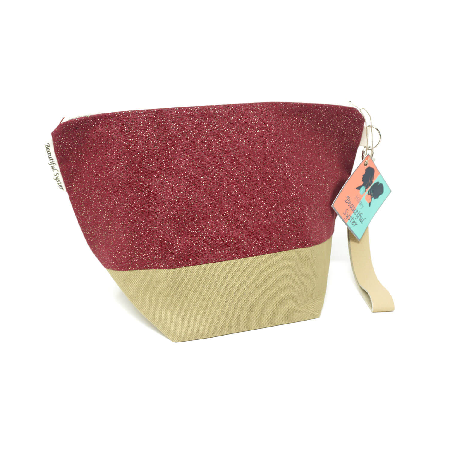 Beautiful Syster Hillary zipped project bag with beige and red sparkle fabric. Bag is standing up.