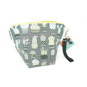 Beautiful Syster Ismira zipped project bag with cactus fabric. Bag is stood up.