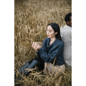 Laine Magazine - Issue 10 - two people wearing knitwear in a field | Yarn Worx