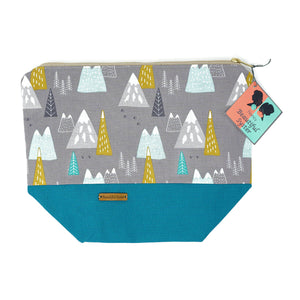 Beautiful Syster Nancy zipped project bag with teal and grey with coloured mountains. Bag is closed and laying flat.