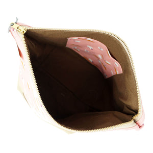 Beautiful Syster Nancy zipped project bag with white sheep and pink fabric. Image is a birds eye view.
