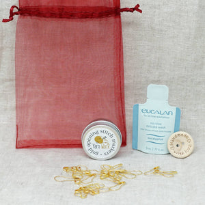 Yarn Worx Stitch Marker, Wooden Button & Wool Wash Kit shown as separate components | Yarn Worx