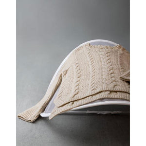 Cocoknits - Sweater Care Kit showing the mesh popup dryer with a sweater on top | Yarn Worx