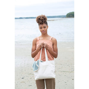 Making Magazine - No 9 - Simple woman holding bag on beach | Yarn Worx