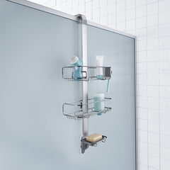 over door adjustable shower caddy - lifestyle hanging over door with props image