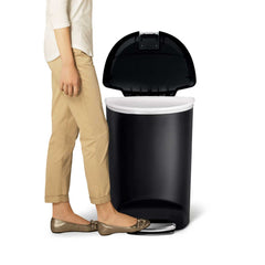 50L semi-round plastic step trash can - black - lifestyle foot on pedal image