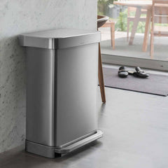 45L rectangular step can with liner pocket - brushed finish - lifestyle up against wall