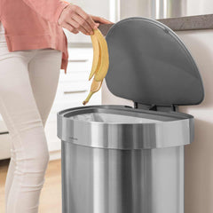 45L semi-round step can with liner rim - brushed finish - lifestyle lid open woman throwing away banana image
