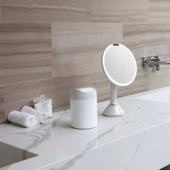 mini can - white stainless steel w/ grey trim - lifestyle on counter with mirror and cotton balls image