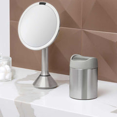 mini can - brushed stainless steel w/ grey trim - lifestyle on counter with mirror and cotton balls image
