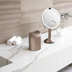 mini can - rose gold stainless steel w/ pink trim - lifestyle on counter with mirror and cotton balls image
