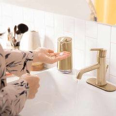 foam sensor pump - brass finish - lifestyle hand using pump in bathroom