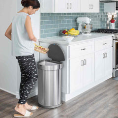 45L semi-round sensor can - brushed finish - lifestyle woman scraping off food in kitchen