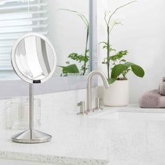 sensor mirror fold - brushed finish - lifestyle mirror on bathroom sink image