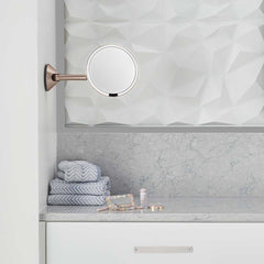 hard-wired wall mount sensor mirror - rose gold finish - lifestyle in bathroom image