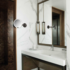 hard-wired wall mount sensor mirror - dark bronze finish - lifestyle in bathroom image