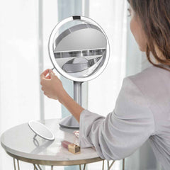 sensor mirror trio - brushed finish - lifestyle woman flipping mirror