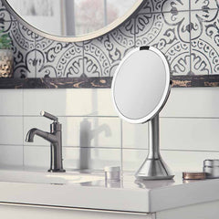 sensor mirror with touch-control brightness and dual light setting - brushed finish - lifestyle in bathroom image