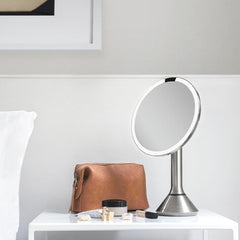 sensor mirror with touch-control brightness and dual light setting - brushed finish - lifestyle in bedroom image