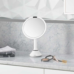 sensor mirror with touch-control brightness and dual light setting - white finish - lifestyle in bedroom image