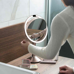 sensor mirror trio - rose gold finish - lifestyle woman flipping mirror