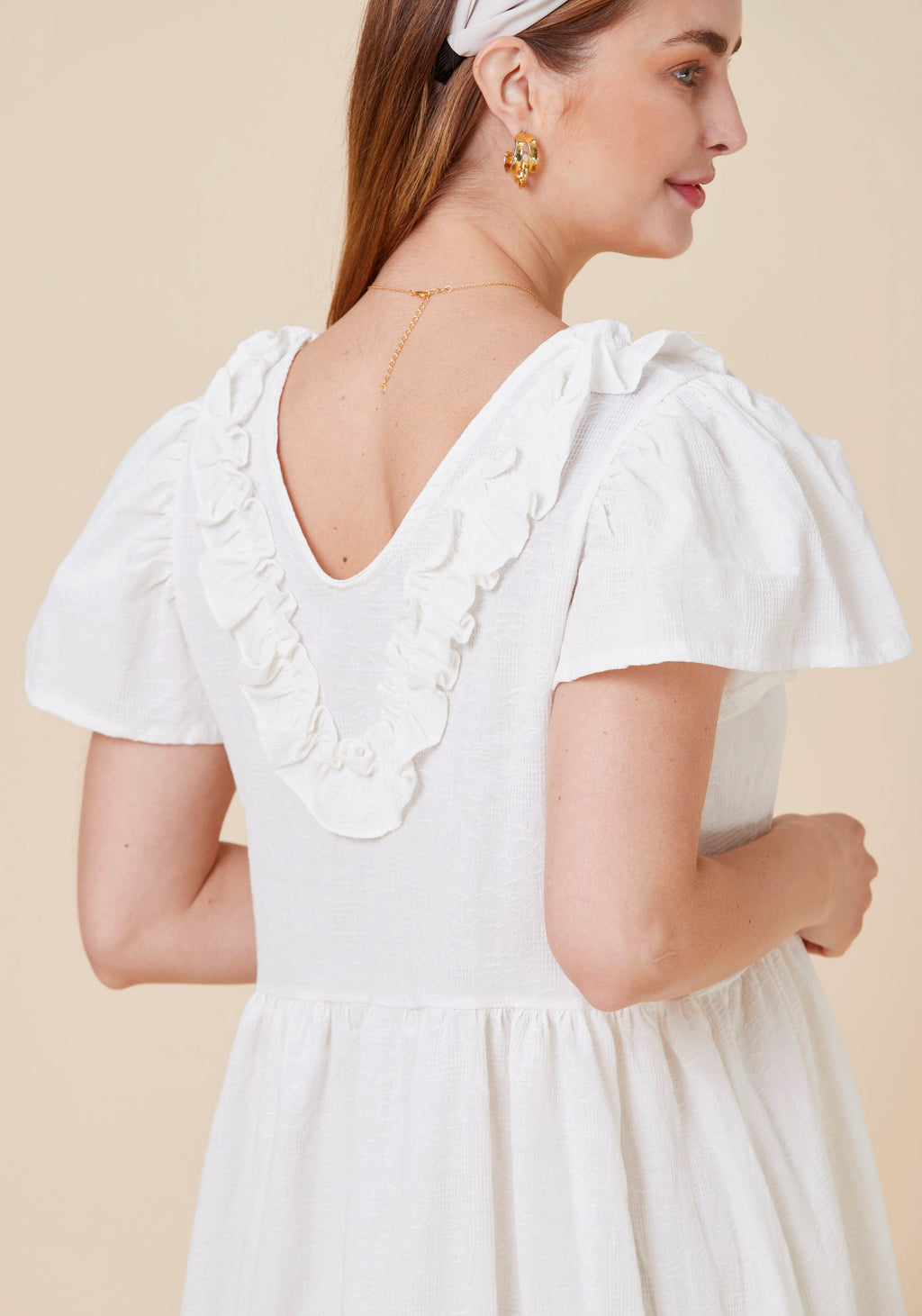 TEXTURED RUFFLE DRESS