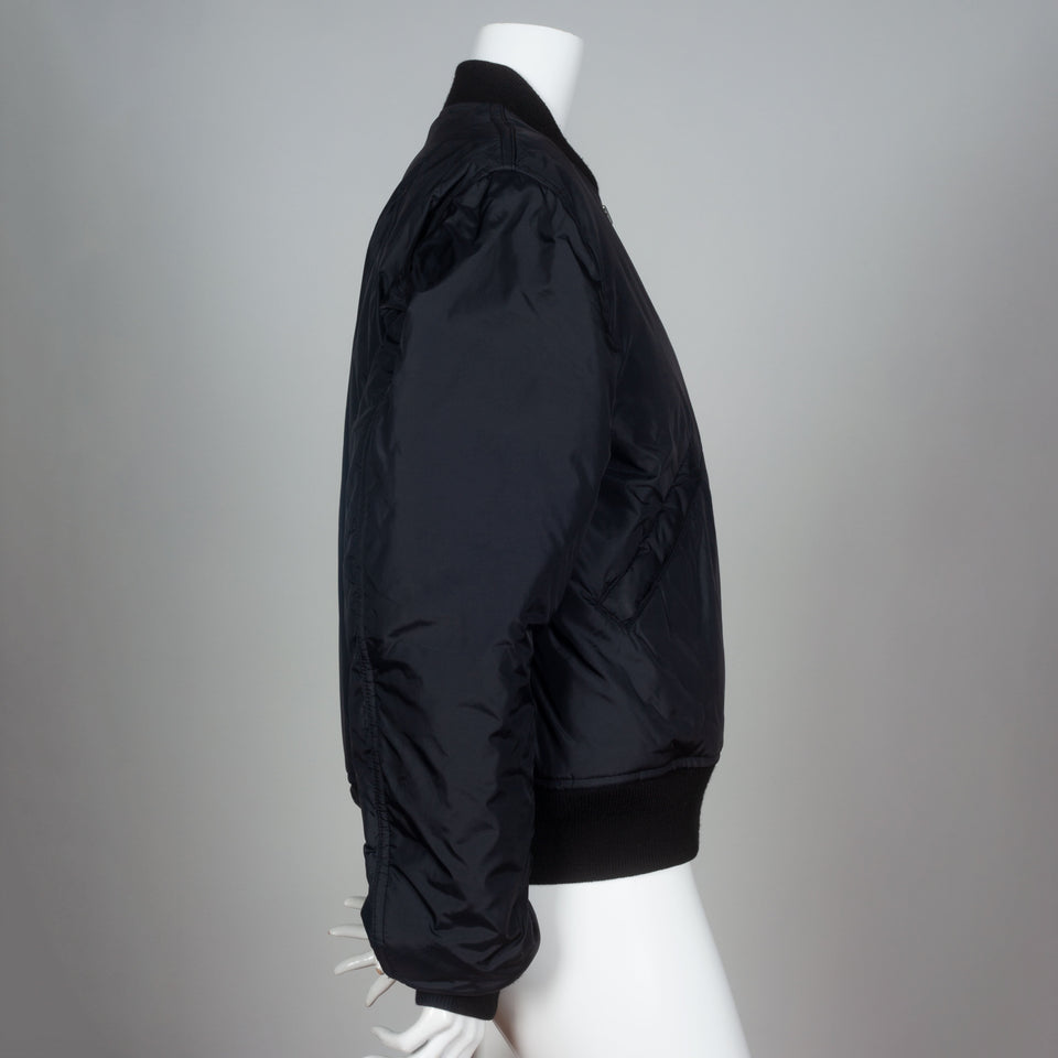 Black Comme des Garçons 2013 nylon bomber jacket from Japan.