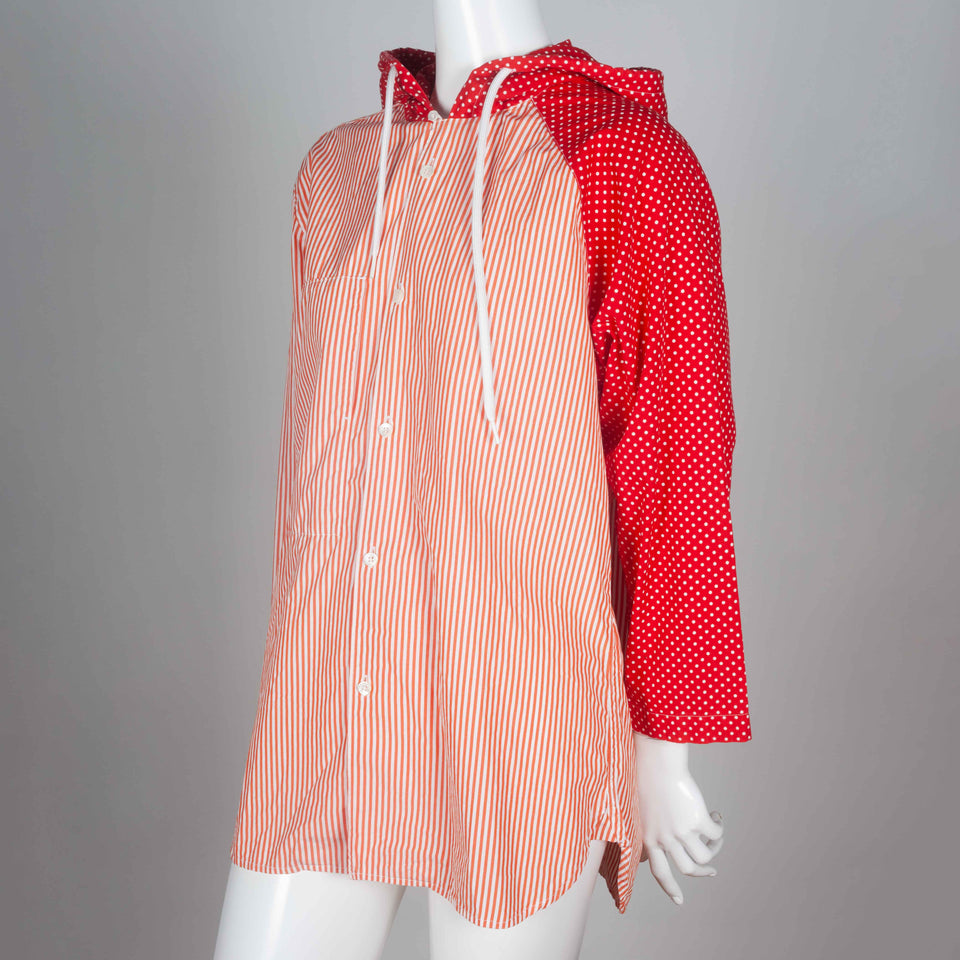 Comme des Garçons red and white poplin shirt with draw string hood and asymmetric pattern.