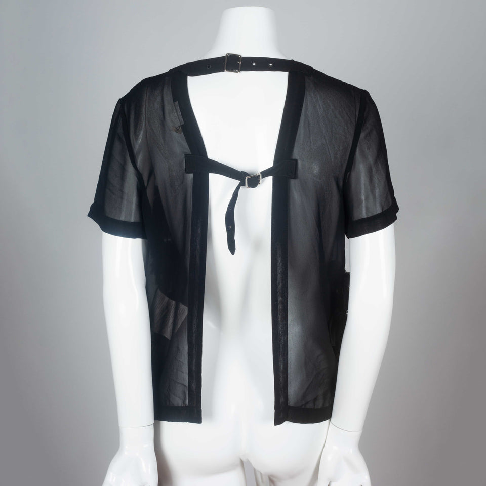 Comme des Garçons 2014 black chiffon short sleeve blouse with ruffled front and open back.