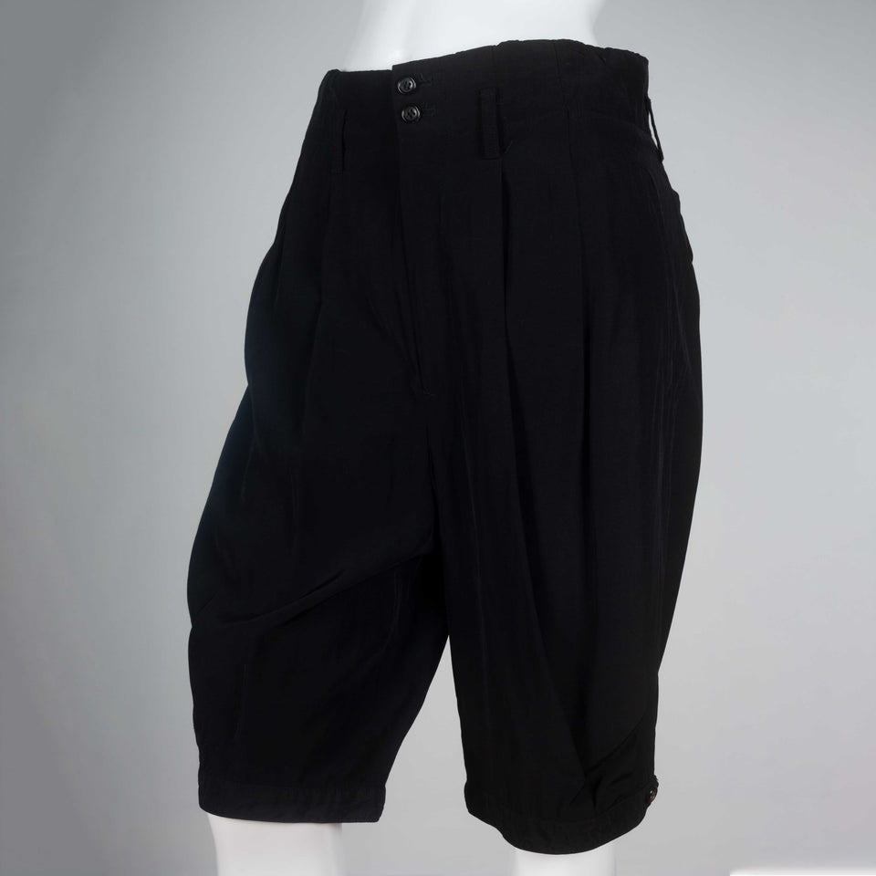Comme des Garçons 1998 black, knee-length silk shorts from Japan.