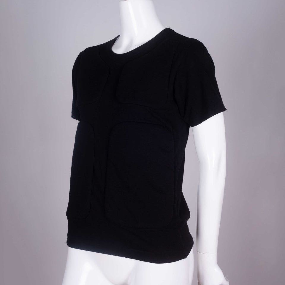 Comme des Garçons 2016 black crew neck tee from Japan with four sections of padding on the front chest and torso.