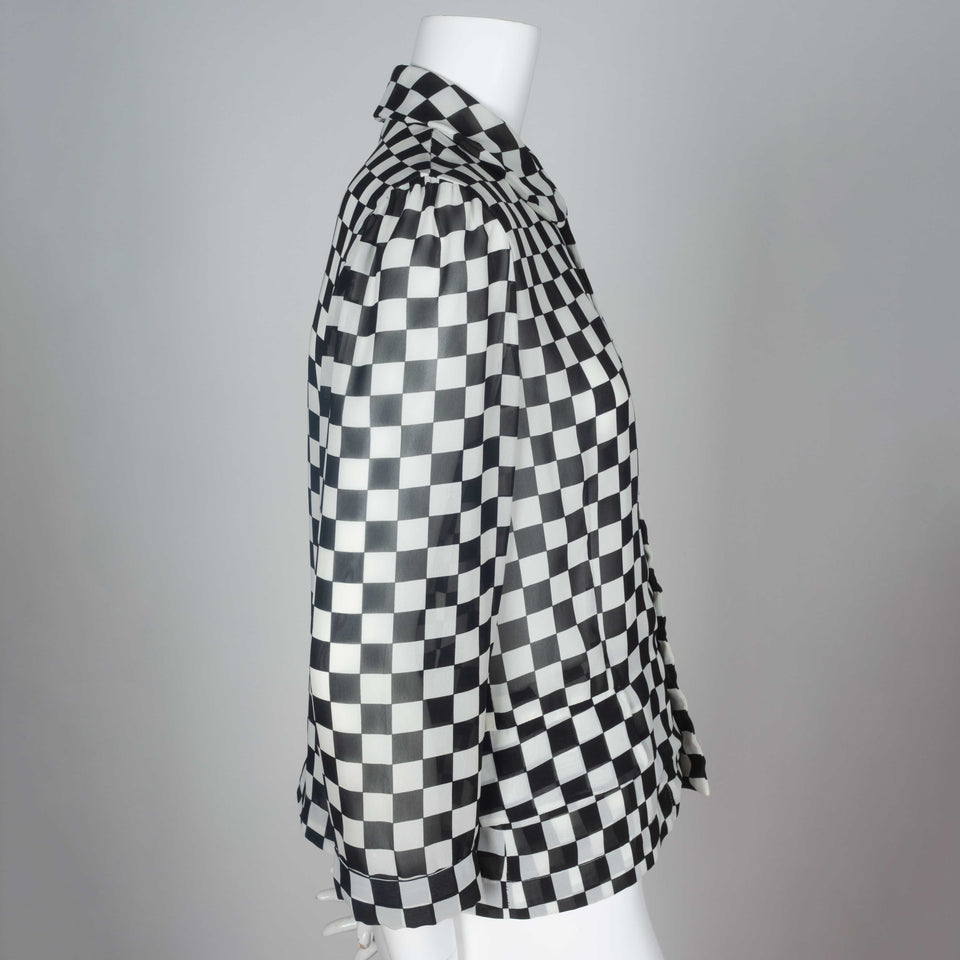 A 1996 chiffon long sleeve blouse from Japan by Comme des Garçons with black and white checkered print and peter pan collar.