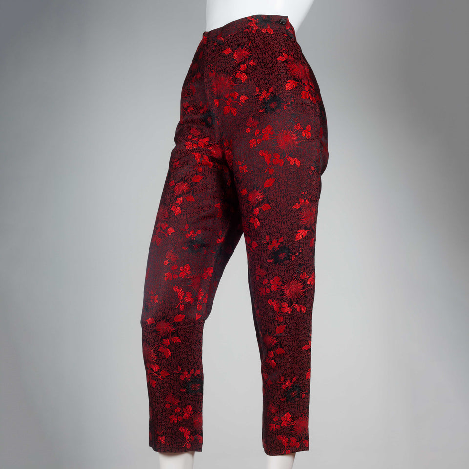 Comme des Garçons 1991 black trousers with bright red all-over flower and leaf embroidery.