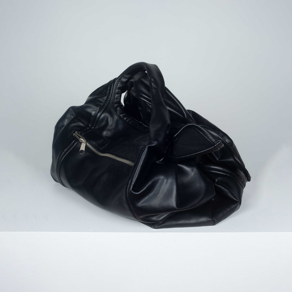 Comme des Garçons black purse from Japan in soft synthetic leather.