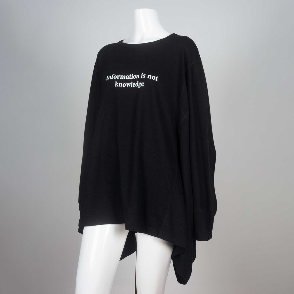 "Kimono sleeved black t-shirt from Japan with visible surge stitching and a message in white lettering, ""Information is not knowledge."""